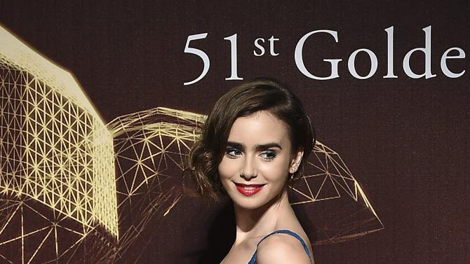 U.S. actress Lily Collins poses for photographers on the red carpet at the 51st Golden Horse Film Awards in Taipei