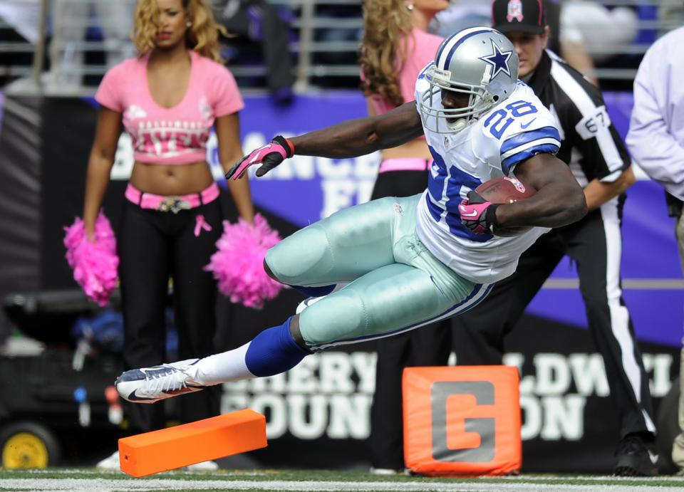 Dallas Cowboys running back Felix Jones falls into the end zone for a touchdown in the first half of an NFL football game against the Baltimore Ravens in Baltimore, Sunday, Oct. 14, 2012. (AP Photo/Nick Wass)