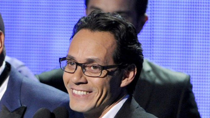 FILE - In this Nov. 20, 2014 file photo, Marc Anthony, winner of the award for best salsa album, speak on stage at the 15th annual Latin Grammy Awards at the MGM Grand Garden Arena in Las Vegas. Anthony founded Magnus Media this year. The company said Monday, Nov. 30, 2015, it is forming a joint venture that will represent Cincinnati Reds closer Aroldis Chapman. (Photo by Chris Pizzello/Invision/AP, File)