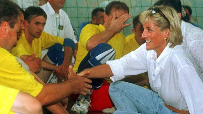 "File-This Aug. 9, 1997 file photo shows Britain's Diana, Princess of Wales, meets with members of a Zenica volleyball team who have suffered injuries from mines. British police say they are examining newly received information relating to the deaths of Princess Diana and Dodi Fayed, and that officers are assessing the information's ""relevance and credibility.""Scotland Yard declined to provide details about the information, only saying Saturday Aug. 17, 2013, in a statement that the assessment will be carried out by officers from its specialist crime and operations unit. (AP Photo/Ian Waldie, File)"