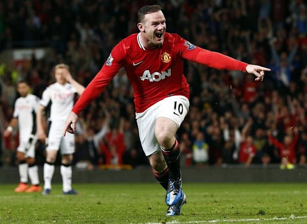 Manchester United's Rooney celebrates his goal against Fulham during their Premier League match in Manchester