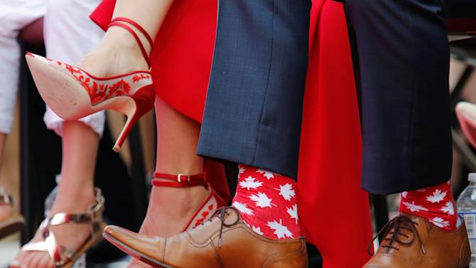 Canada's PM Trudeau wears maple leaf-themed socks during Canada Day celebrations on Parliament Hill in Ottawa