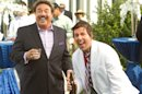 This film image released by Columbia Pictures shows Tony Orlando, left, and Adam Sandler in a scene from