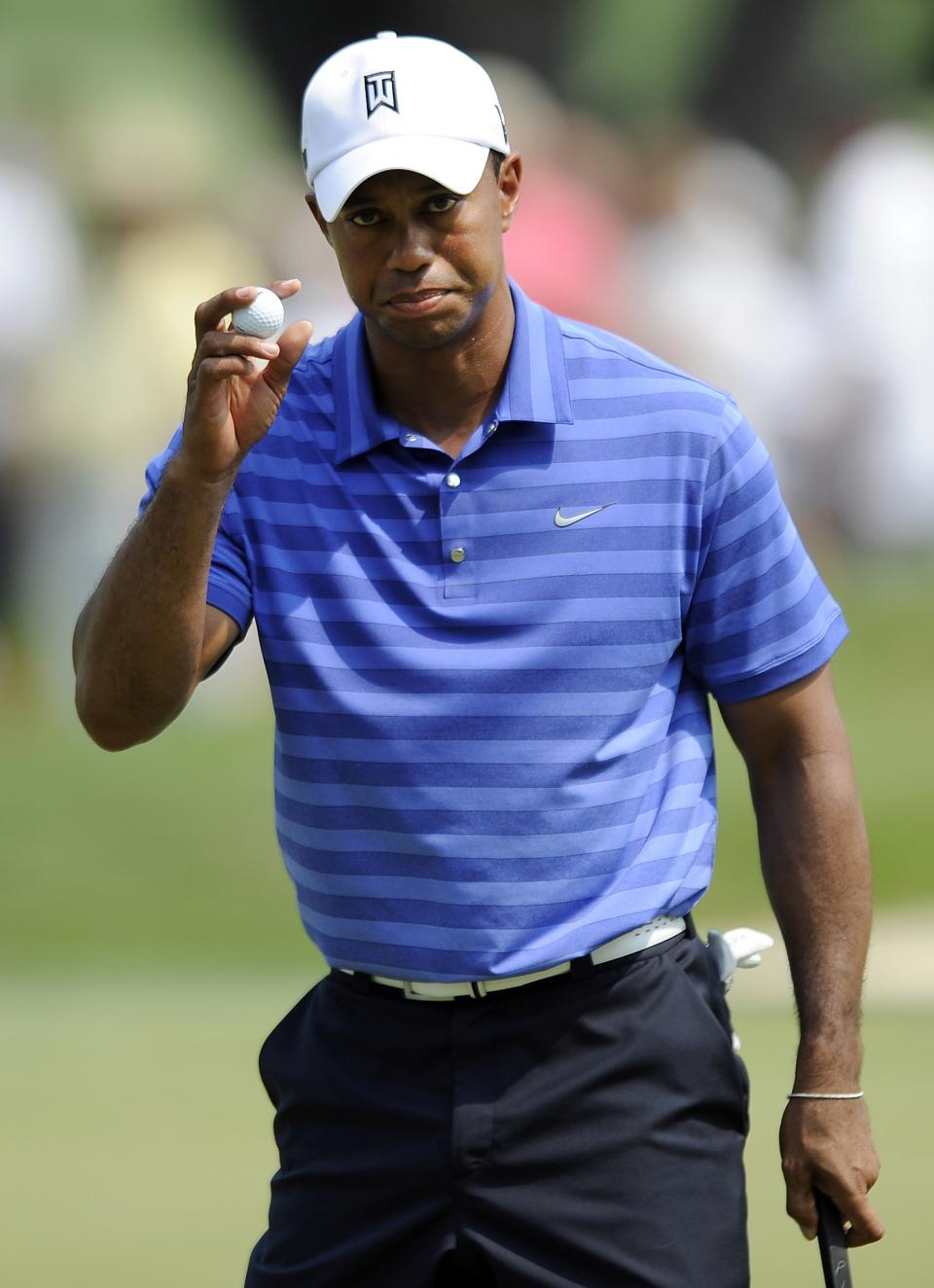 Tiger Woods acknowledges the gallery after making par on the third green during the second round of the AT&T National golf tournament at Congressional Country Club in Bethesda, Md., Friday, June 29, 2012. (AP Photo/Nick Wass)