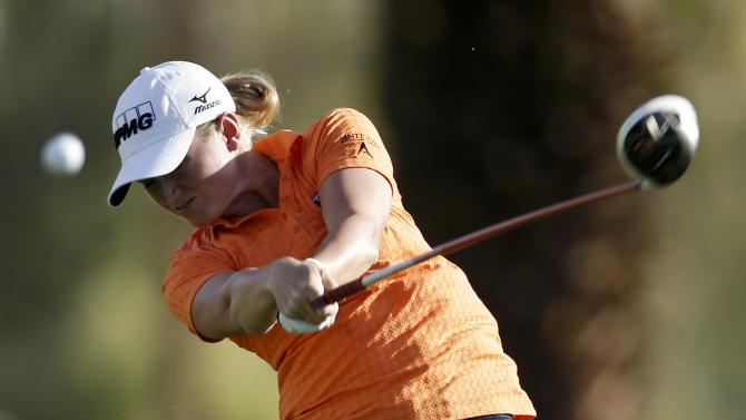 Stacy Lewis hits from the tee on the 11th hole during the first round of the LPGA Kraft Nabisco Championship golf tournament in Rancho Mirage, Calif. Thursday, April 4, 2013. (AP Photo/Chris Carlson)