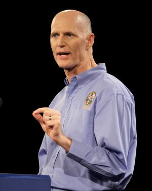 In this Saturday, Sept 24, 2011, photo, Florida Gov. Rick Scott delivers his keynote address at a Florida Republican Party Presidency 5 Convention in Orlando, Fla. A federal judge temporarily blocked Florida's new law that requires welfare applicants to pass a drug test before receiving the benefits on Monday, Oct. 24, 2011. The judge said it may violate the Constitution's ban on unreasonable searches and seizures. Gov. Rick Scott was a proponent for law. (AP Photo/John Raoux)