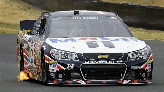 Tony Stewart races during the NASCAR Sprint Cup series auto race, Sunday, June 23, 2013, in Sonoma, Calif. (AP Photo/Ben Margot)