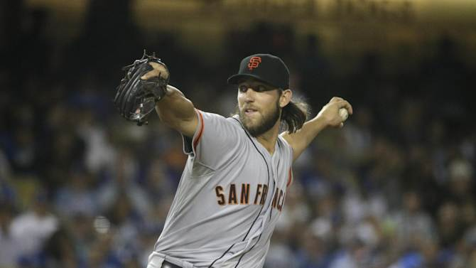 San Francisco Giants starting pitcher Madison Bumgarner throws against the Los Angeles Dodgers during the seventh inning of a baseball game Tuesday, Sept. 23, 2014, in Los Angeles. (AP Photo/Jae C. Hong)