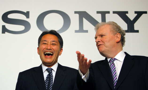 FILE - In this Feb. 2, 2012 file photo, Sony Corp. President and Chief Executive Officer to be Kazuo Hirai, left, and outgoing CEO Howard Stringer have a light moment following their press conference in Tokyo. Sony now has a new president - Hirai, the former head of its game division. But shareholders are already raising doubts about his ability to revive the Japanese electronics and entertainment giant. (AP Photo/Junji Kurokawa, File)