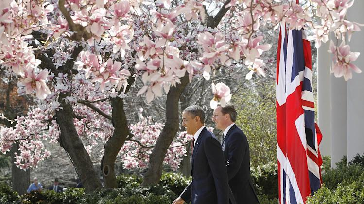 President Barack Obama and British Prime Minister David Cameron arrives for their joint news conference in the Rose Garden of the White House in Washington, Wednesday, March 14, 2012. (AP Photo/Charles Dharapak)