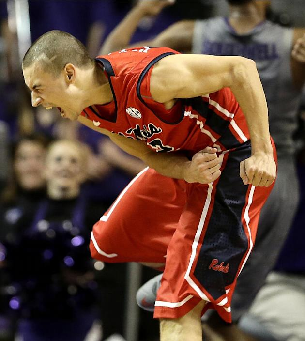 Mississippi's Marshall Henderson celebrates after a teammate made a basket during the second half of an NCAA college basketball game against Kansas State Thursday, Dec. 5, 2013 in Manhattan, Kan.