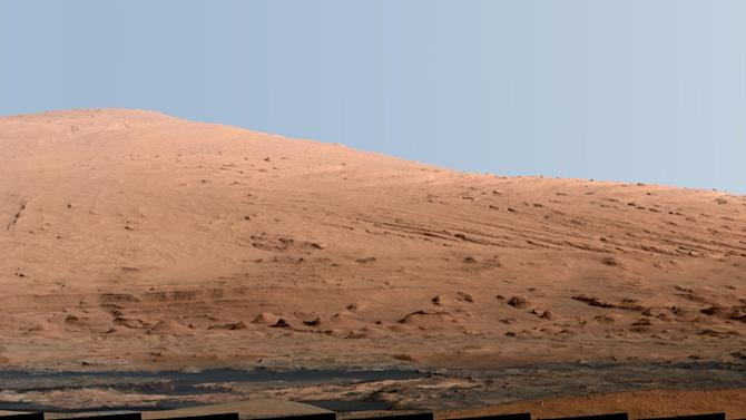 This composite image released by NASA shows a panoramic view of Mount Sharp, made from dozens of images. The Martian mountain is the ultimate destination for the Curiosity rover. NASA scientists said Monday March 18, 2013, the rover went into safe mode over the weekend, further delaying the restart of science experiments. (AP Photo/NASA)