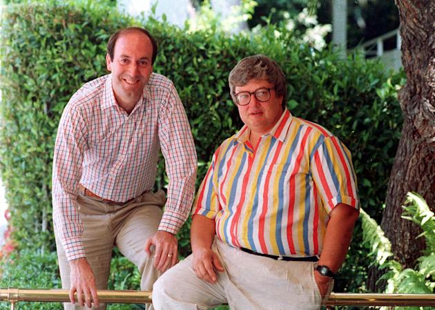 FILE - This 1986 photo shows Roger Ebert, right, and Gene Siskel in Los Angeles. Ebert, the nation's best-known film reviewer who with fellow critic Siskel created the template for succinct thumbs-up