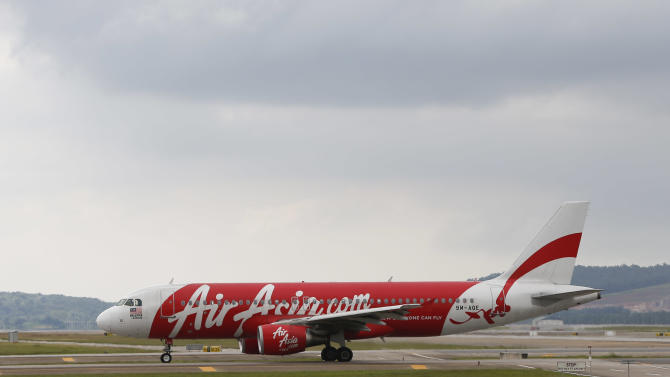 In this Nov. 26, 2014 photo, AirAsia Airbus A320-200 passenger jets are taxing on the tarmac at low cost terminal KLIA2 in Sepang, Malaysia. An AirAsia plane with 161 people on board lost contact with ground control on Sunday, Dec. 28, 2014, while flying over the Java Sea after taking off from a provincial city in Indonesia for Singapore, and search and rescue operations were underway. The plane in this photo is not the plane that went missing while flying from Indonesia to Singapore but one of the same models.  (AP Photo/Vincent Thian)