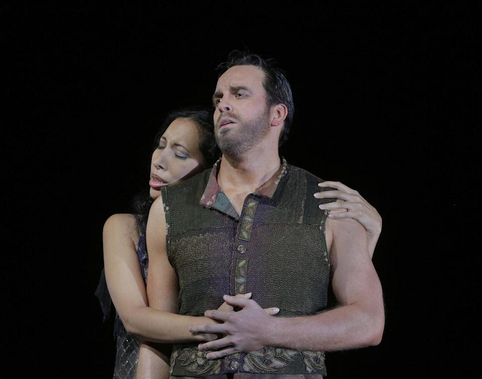 "In this undated photo provided by the Santa Fe Opera, soprano Nicole Cabell, left, and baritone Christopher Magiera perform in the Santa Fe Opera production of Georges Bizet's ""The Pearl Fishers."" (AP Photo/Santa Fe Opera, Ken Howard)"