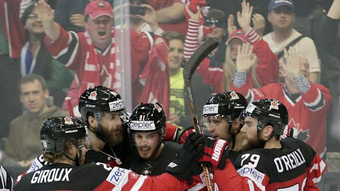Canadian players celebrate a goal against Sweden during the Hockey World Championships Group A match in Prague, Czech Republic, Wednesday, May 6, 2015. (AP Photo/Petr David Josek)