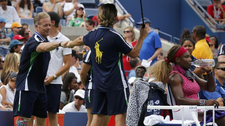 Military veteranTodd Reed works as a ball boy at the 2014 U.S. Open tennis tournament in New York