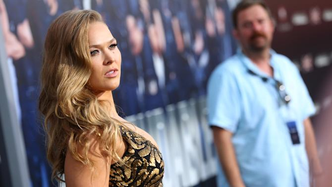 """Ronda Rousey arrives at the Lionsgate Los Angeles premiere of """"The Expendables 3"""" at TCL Chinese Theatre on Monday, Aug. 11, 2014, in Hollywood, Calif. (Photo by Alexandra Wyman/Invision for Lionsgate/AP Images)"""
