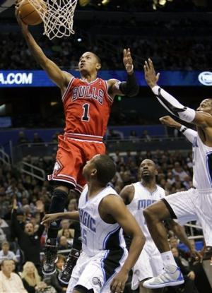 Late spurt lifts Rose and Bulls over Magic, 97-83