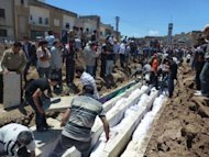 Shaam News Network photo claims to show show people watching the burial on May 26 of more than 100 massacre victims in the Syrian town of Houla. Kofi Annan told President Bashar al-Assad of the world&#39;s &quot;grave concern&quot; about violence in Syria, including the Houla massacre, in a meeting Tuesday, the envoy&#39;s office said. AFP is using pictures from alternative sources as it was not authorised to cover this event