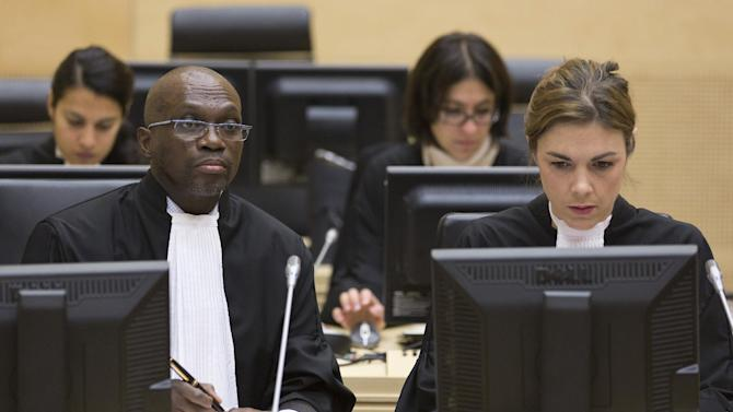 Representatives of the Office of Public Counsel for the Defence, Xavier-Jean Keita, left, and Melinda Taylor, right, are seen in the International Criminal Court (ICC) in The Hague Tuesday Oct. 9, 2012.  The International Criminal Court is holding a two-day hearing into where the eldest son of former Libyan dictator Moammar Gadhafi should be put on trial. Seif al-Islam Gadhafi is charged by the international court with crimes against humanity for his alleged involvement in the deadly crackdown on dissent against his father's rule. However Libyan authorities say they want to prosecute him at home, where he is being held. (AP Photo/Michael Kooren, POOL)