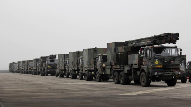 A camouflage convoy of Dutch military trucks carrying two batteries of Patriot missiles is lined up for a media opportunity before departing De Peel Air Base in Vreedepeel, southern Netherlands, Monday Jan. 7, 2013. A total of 12 Patriot missile launching systems from the Dutch military are on its way to help Turkey defend its border against Syrian rockets. The missile batteries are being shipped to Turkey and are scheduled to be fully operational by January 26th. (AP Photo/Mark D. Carlson)