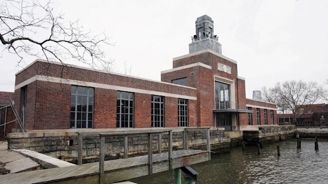 """FILE - This March 26, 2007, file photo shows the ferry building on Ellis Island, N.J. The National Park Service said Sunday, March 24, 2013 that the Ellis Island Immigration Museum """"will not likely be open in 2013"""" as damage from Superstorm Sandy is repaired. The island, adjacent to the one that is home to the Statue of Liberty, sustained severe damage to its infrastructure in the October 2012 storm. (AP Photo/Mike Derer, File)"""