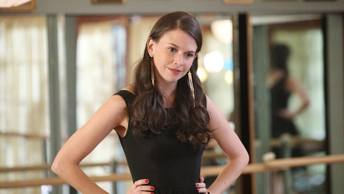 """This image released by ABC Family shows actress Sutton Foster portraying Michelle Simms in a scene from """"Bunheads, """" on ABC Family. Foster, a three-time Tony winner, plays a Las Vegas showgirl who marries, moves to a small town and runs a dance school with her mother-in-law. (AP Photo/ABC Family, Adam Taylor)"""