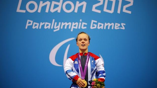 Eleanor Simmonds of Britain sings the national anthem during the victory ceremony after winning 400m Freestyle S6 final in world record time on the third day of the London 2012 Paralympic games (Reuters)
