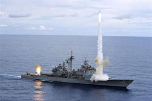 The Ticonderoga-class guided-missile cruiser USS Cowpens (CG 63) fires Standard Missiles (SM) 2 missiles at an airborne drone during a live-fire weapons shoot in the Pacific Ocean in this handout photo taken September 20, 2012 and released to Reuters on September 25, 2012. REUTERS/Paul Kelly/U.S. Navy photo/Handout/Files