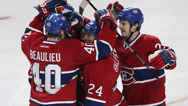 Montreal Canadiens center Jeff Halpern (24) is congratulated by team mates on his goal against the Carolina Hurricanes (Reuters)