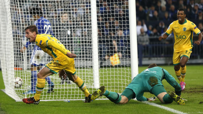 Sporting's Adrien Silva scores his second goal during the Champions League group G soccer match between Schalke 04 and Sporting in Gelsenkirchen, Germany, Tuesday, Oct. 21, 2014.(AP Photo/Frank Augstein)