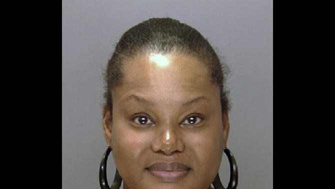 "FILE - In this undated file photo provided by the Philadelphia Police Department, Padge Victoria Windslowe is seen. Windslowe, who calls herself the ""Black Madam,"" was arrested Monday, July 23, 2012 on charges connected to the February 2011 death of Claudia Aderotimi following buttocks injections at a Philadelphia hotel, police said. Court records indicated Windslowe was arraigned Tuesday morning.  (AP Photo/Philadelphia Police Department, File)"