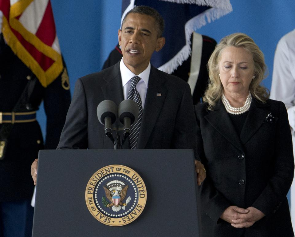 President Barack Obama, accompanied by Secretary of State Hillary Rodham Clinton, speaks during a Transfer of Remains Ceremony, Friday, Sept. 14, 2012, at Andrews Air Force Base, Md., marking the return to the United States of the remains of the four Americans killed this week in Benghazi, Libya. (AP Photo/Carolyn Kaster)