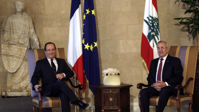 "Lebanese President Michel Suleiman, right, poses for photographers with French President Francois Hollande, left, at the Presidential Palace in Baabda, east of Beirut, Lebanon, Sunday, Nov. 4, 2012. Hollande said France will stand against instability in Lebanon. Hollande's comments during a short visit to Beirut come as many in Lebanon fear that Syria's civil war could spill over. Speaking to reporters after meeting President Michel Suleiman, Hollande said that amid Syria's civil war, ""we are committed to give you guarantees regarding security, stability and the unity of Lebanon.""  A top anti-Syrian intelligence chief was killed in a car bomb in Beirut last month. The assassination stirred up deadly sectarian tensions in Lebanon, where Sunnis and Shiites are deeply divided over the Syrian civil war, raising the specter of renewed sectarian fighting. (AP Photo/Bilal Hussein)"