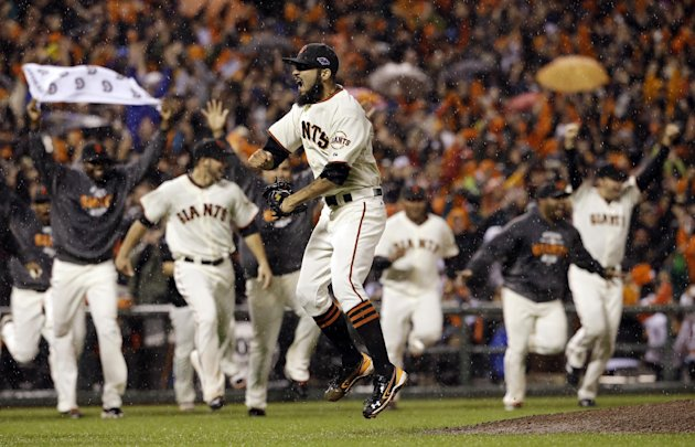 San Francisco Giants relief pitcher Sergio Romo reacts after the final out in Game 7 of baseball&#39;s National League championship series against the St. Louis Cardinals Monday, Oct. 22, 2012, in San Francisco. The Giants won 9-0 to win the series. (AP Photo/David J. Phillip)