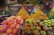 A fruit vendor wait for customers at a market in Jakarta. Indonesia said Monday inflation rose to 4.53 percent in June, spurred by higher basic food prices including red chillies, a main ingredient in local dishes