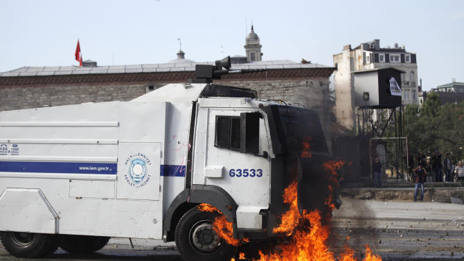 A petrol bomb petrol bomb explodes on a police water cannon truck during clashes in Taksim Square in Istanbul, Turkey, Tuesday, June 11, 2013. Hundreds of police in riot gear forced through barricades in Istanbul's central Taksim Square early Tuesday, pushing many of the protesters who had occupied the square for more than a week into a nearby park. (AP Photo/Kostas Tsironis)