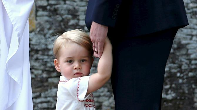 Britain's Prince George arrives for the christening of his sister Princess Charlotte at the Church of St Mary Magdalene on the Sandringham Estate in King's Lynn