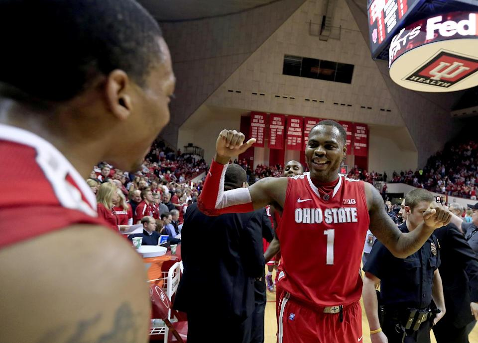Ohio State's Deshaun Thomas (1) celebrates with Lenzelle Smith Jr., after their 67-58 win over Indiana in an NCAA college basketball game, Tuesday, March 5, 2013, in Bloomington, Ind. (AP Photo/Darron Cummings)