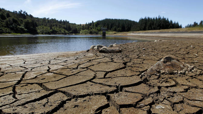 This photo from Feb. 26, 2013 shows dry cracked land near a water reservoir in Kiwitahi, New Zealand. A drought in New Zealand's North Island is costing farmers millions of dollars each day and is beginning to take a toll on the country's economy. (AP Photo/New Zealand Herald, Christine Cornege) NEW ZEALAND OUT, AUSTRALIA OUT