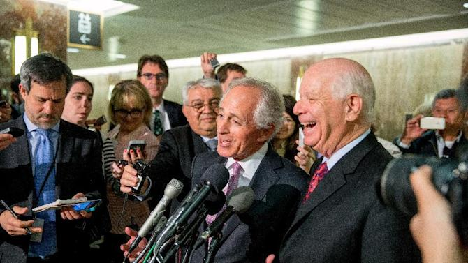 "FILE - In this April 14, 2015 file photo, Senate Foreign Relations Committee Chairman Sen. Bob Corker, R-Tenn., center, and the committee's ranking member Sen. Ben Cardin, D-Md., right, speak to reporters on Capitol Hill in Washington. Senate proponents of a bill empowering Congress to review and potentially reject any Iran nuclear deal must first win a battle with some colleagues determined to change the legislation in ways that could sink it. ""Anybody who monkeys with this bill is going to run into a buzz saw,"" Republican Sen. Lindsey Graham of South Carolina warned ahead of this week's debate. Also trying to discourage any changes, Democratic Sen. Bob Menendez of New Jersey urged senators to stick with the plan as it emerged from the Senate Foreign Relations Committee.   (AP Photo/Andrew Harnik, File)"