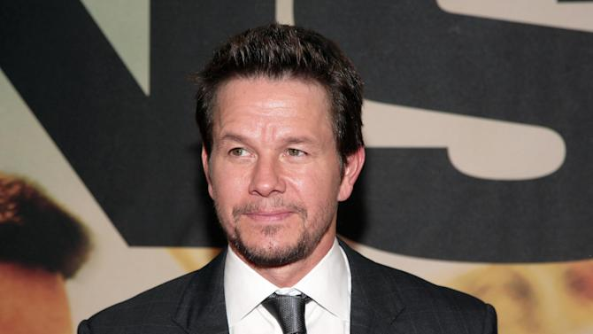 """FILE - This July 29, 2013 file photo shows actor Mark Wahlberg attends the premiere of """"Two Guns"""" in New York. wahlberg will star in a new reality show, titled """"Wahlburgers,"""" set in his family's Boston restaurant. For the show, actor brothers Mark and Donnie Wahlberg head back to their hometown to join forces with older brother Paul in the hamburger venture. """"Wahlburgers"""" premieres January 22. (Photo by Andy Kropa/Invision/AP, File)"""