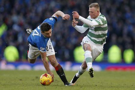 Celtic's John Guidetti challenges Rangers' Darren McGregor during their Scottish League Cup semi final soccer match  at Hampden Park stadium in Glasgow, Scotland