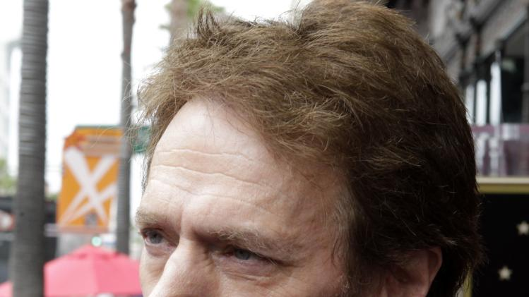File photo of film and television producer Jerry Bruckheimer being interviewed following ceremonies honoring Bruckheimer with a star on the Hollywood Walk of Fame