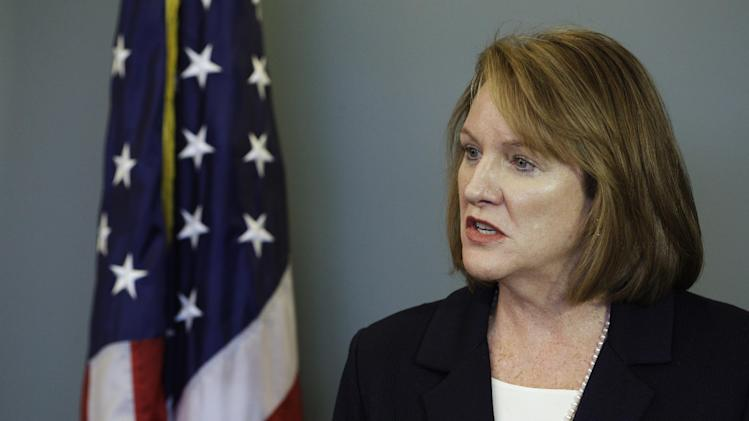 U.S. Attorney Jenny Durkan talks to reporters Wednesday, Oct. 24, 2012, in Seattle, after Algerian terrorist Ahmed Ressam was sentenced to 37 years in prison for plotting to bomb Los Angeles International Airport around the turn of the new millennium. (AP Photo/Ted S. Warren)