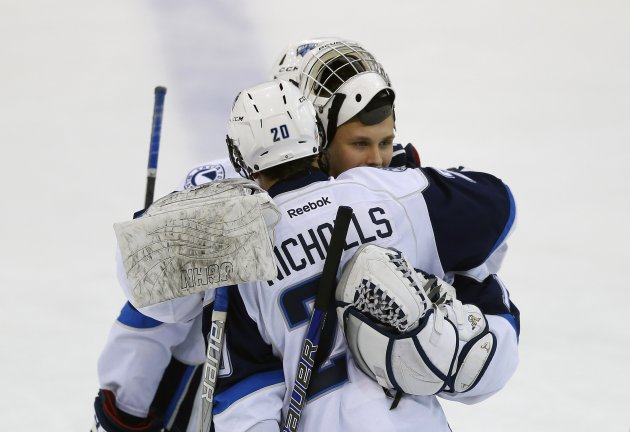 Saskatoon Blades' Makarov gets hugged by Nicholls after they were defeated by the London Knights during the Memorial Cup Canadian Junior Hockey Championships in Saskatoon.