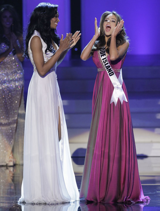 Miss Rhode Island Olivia Culpo reacts after being announced the 2012 Miss USA, as Miss Maryland Nana Meriwether applauds during the Miss USA pageant, Sunday, June 3, 2012, in Las Vegas. (AP Photo/Juli