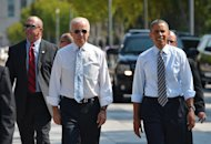 US President Barack Obama and US Vice President Joe Biden walk on Pennsylvania Avenue from the White House to get lunch at a nearby deli in Washington, DC on October 4, 2013