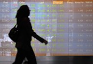 A woman walks past Jakarta's stock exchange in June 2012. Indonesia said Monday the local subsidiary of US mining giant Freeport-McMoRan was willing to sell a stake on Jakarta's stock market, but had not agreed to divest the majority share the government sought